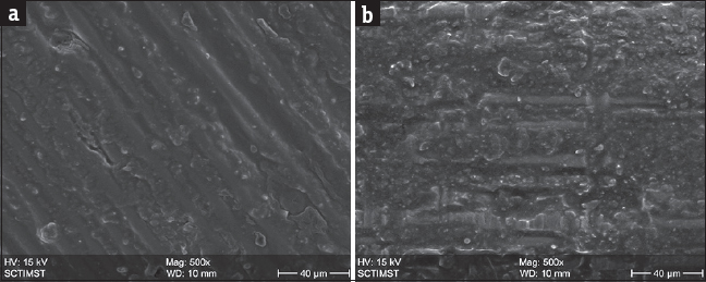 Figure 6: (a) Scanning electron microscopic photograph of glass fiber post with silanization alone revealing very minimal surface modification. (b) Scanning electron microscopic photograph of quartz fiber post with silanization alone revealing very minimal post surface modification